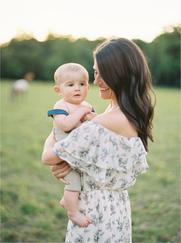 mom and son smiling for a sunset family session