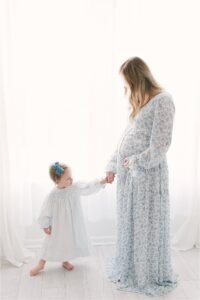 Mother-daughter photo during maternity session with Lindsay Konopa Photography in Carmel, Indiana.