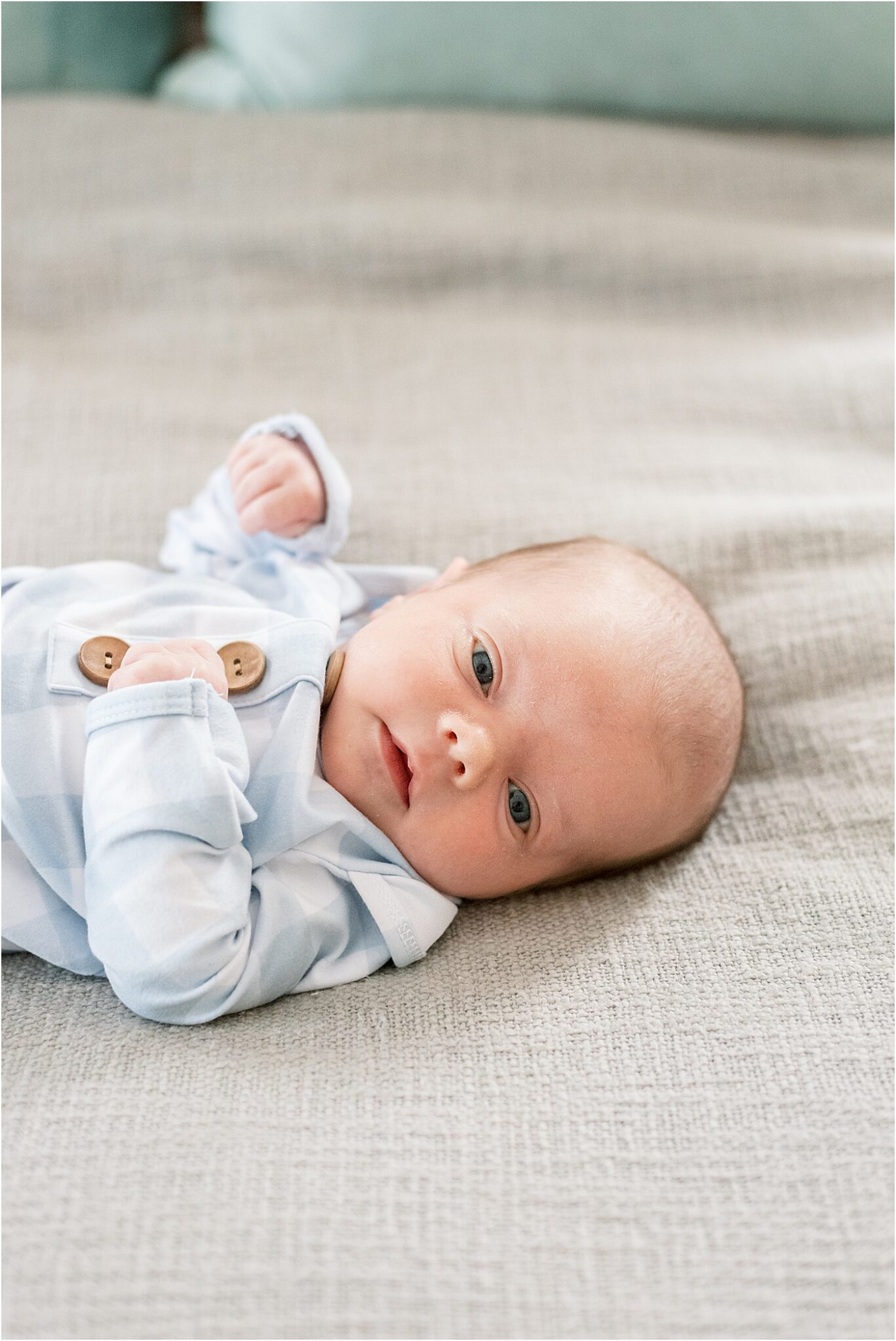 Baby boy laying in bed for in-home lifestyle newborn session with Carmel Photographer, Lindsay Konopa Photography.