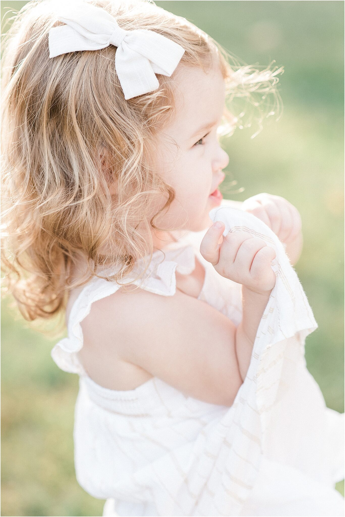 Sweet photo of toddler-aged girl during family session with Lindsay Konopa Photography in Noblesville, Indiana.