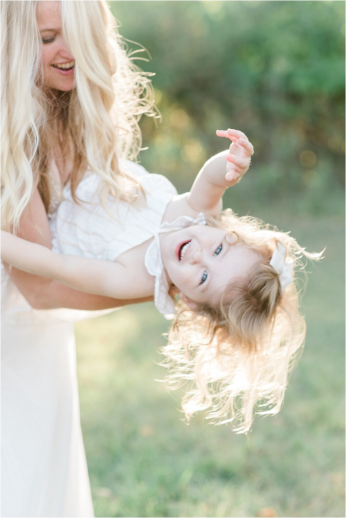 Little girl laughing as Mom dances with her. Photo by Lindsay Konopa Photography.