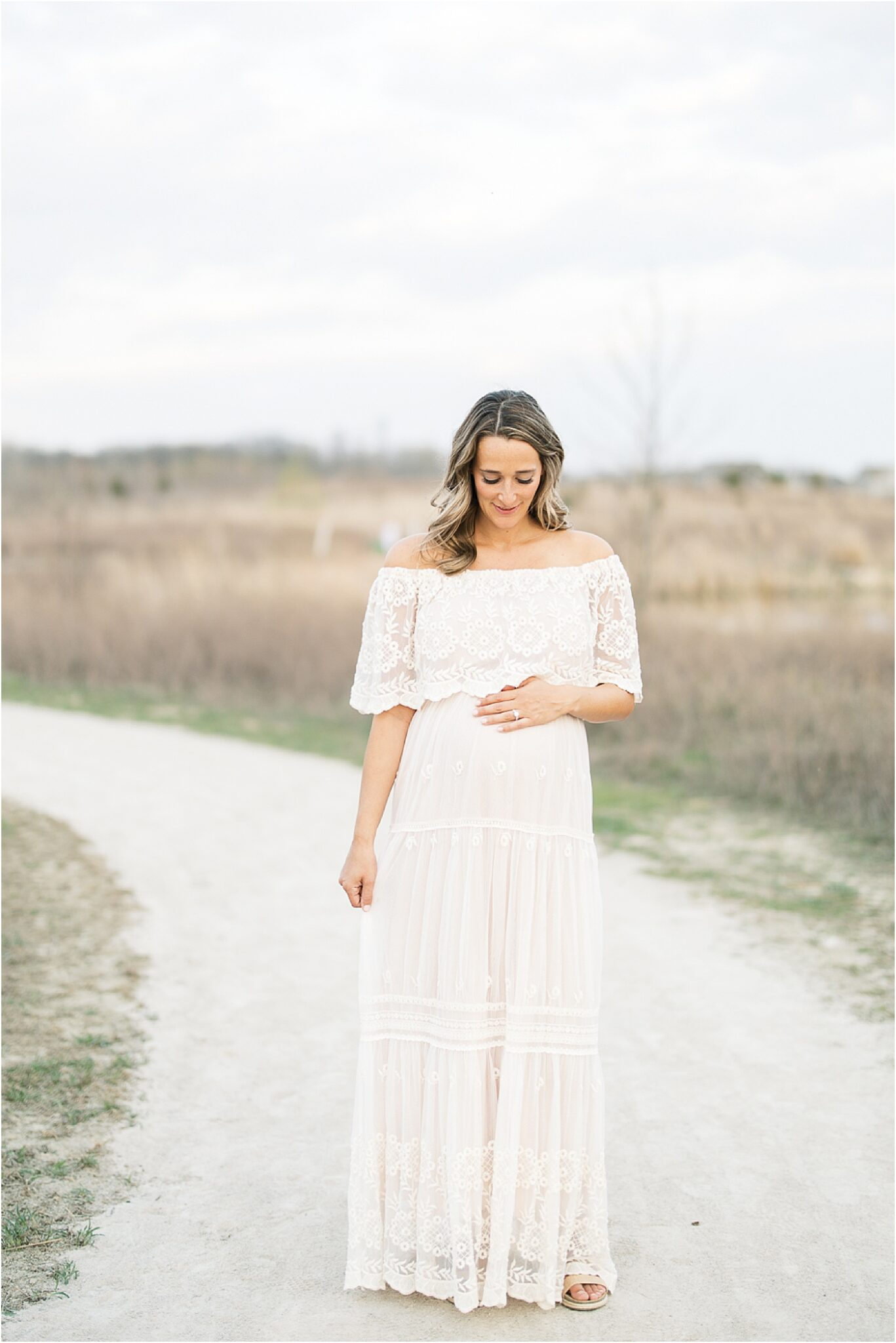 Pregnant mom walking in beautiful lace dress for photos with Lindsay Konopa Photography.