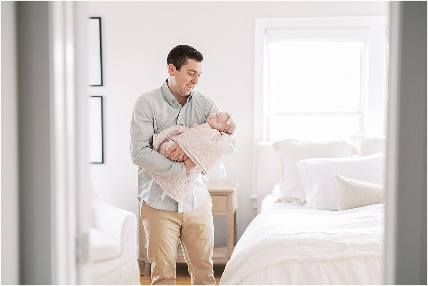 Lifestyle newborn session with Dad holding his baby girl. Photo by Lindsay Konopa Photography.