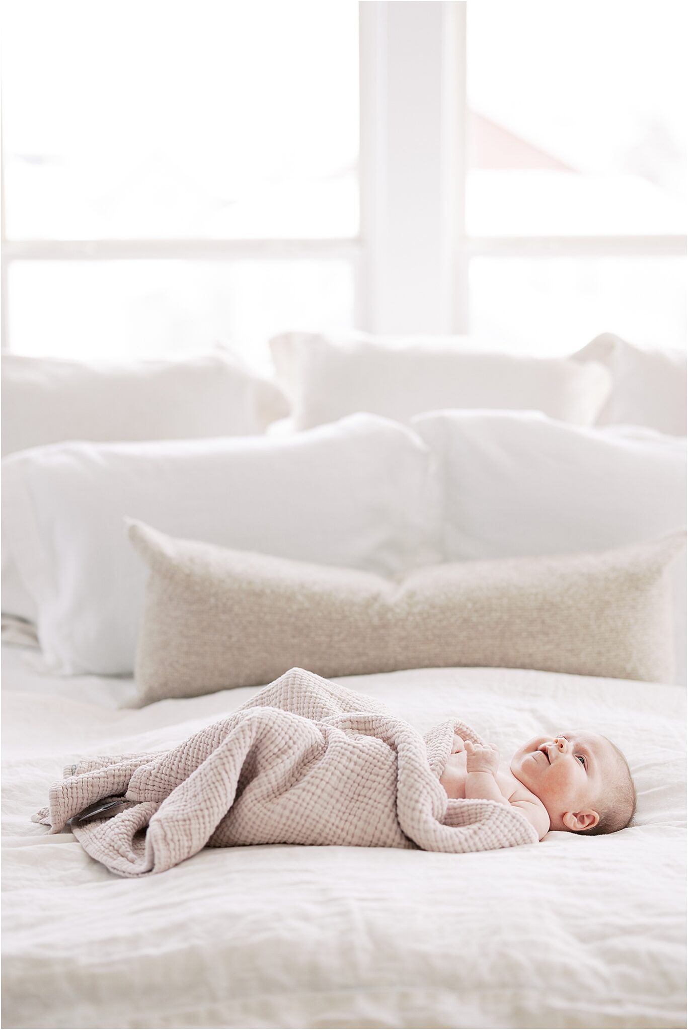 Baby girl laying on bed for lifestyle newborn session with Indianapolis Lifestyle Newborn Photographer, Lindsay Konopa Photography.
