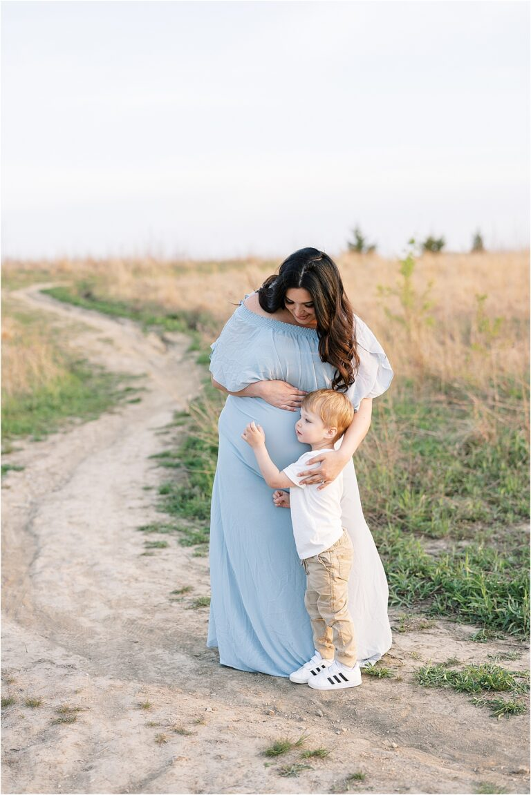 Big brother hugging Mom's belly during maternity session with Lindsay Konopa Photography.