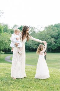 Mom dancing with her daughters. Photo by Lindsay Konopa Photography